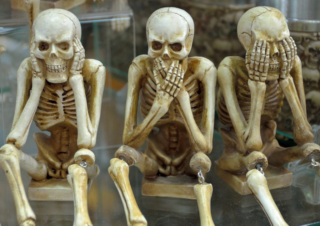 three skeletons with no hear, no talk, no see gestures